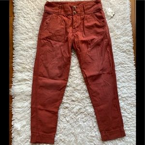 Faded red button fly cotton pants